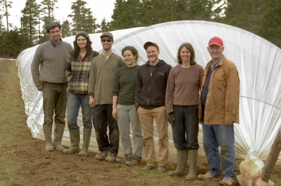 Week 17 - Tunnel Crew. One day, 900 feet of plastic... Kent, Amanda, Jeremie, Sarah, Peter, Ruth, Don and Sylvestre taking the photo.